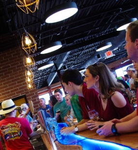 SweetWater fans eagerly await a pour.