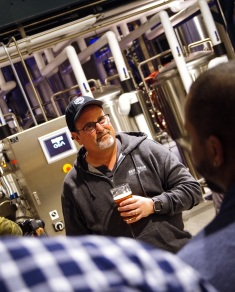 Mitch Steele leads a brewery tour.