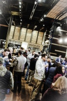 Attendees enjoy beers and a vast array of app-sized portions of dishes that will be featured on the restaurant's menu.