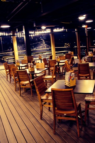 The rooftop deck features a full bar, ample seating, and one hell of a view.